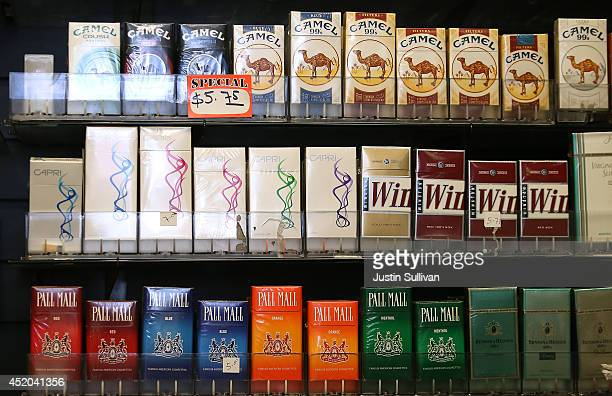 Cigarette brands manufactured by Reynolds Amercian are displayed at a tobacco shop on July 11 2014 in San Francisco California Tobacco giant Reynolds...