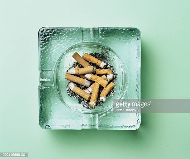 Cigarette butts in ashtray, overhead view