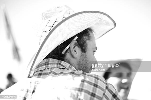 A cigarette is held behind the ear of a bullrider as he waits for his ride in the Bull Ride Spectacular on the first day of the 2014 Deni Ute Muster...