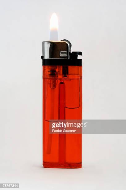 A cigarette lighter with a flame