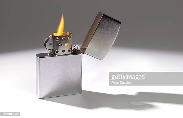 Cigarette lighter with flame