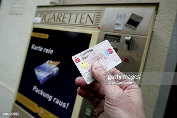 GERMANY BONN Cigarette machine with the function to pay with money card on which the age of the card holder needs to be stored This function is...