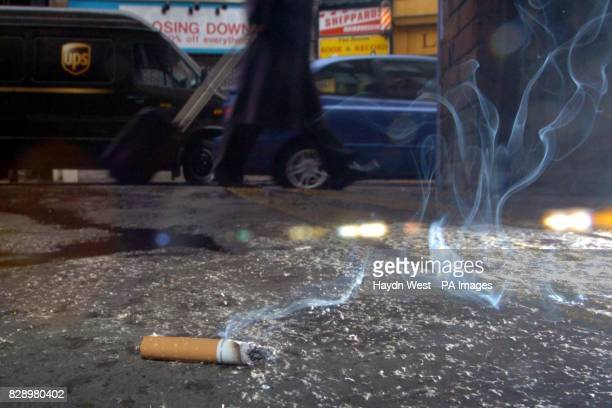 A cigarette on the pavement on Wicklow Street Dublin as a recent report suggests that the ban on smoking in the work place which starts at the end of...