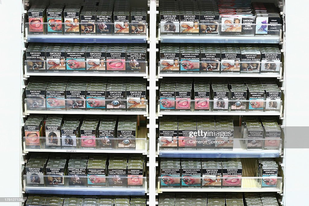 Cigarette packets with health warnings are displayed in a convenience store on August 1, 2013 in Sydney, Australia. In a plan announced today, the government will increase the excise on tobacco by 12.5 per cent annually over the next four years, raising over AUD$5 billion. The hike is estimated to increase the cost of cigarettes by AUD$5 by 2016, and is the first increase in the tobacco excise since 2010.