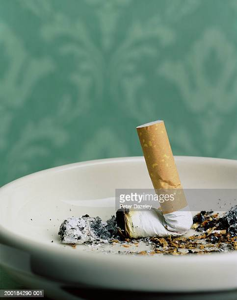 Cigarette stub in ashtray, close-up