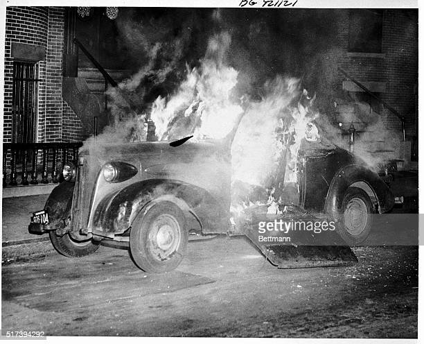 A cigarette tossed into an open window of this parked car in Boston Nov 11 set the vehicle on fire The car was completely destroyed as a result