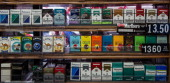 Cigarettes are displayed in a deli on October 31 2013 in New York City New York City's City Council recently passed a bill that raises the legal age...