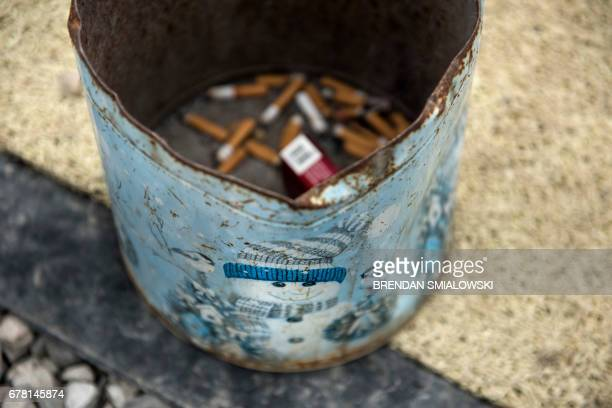 Cigarettes butts are seen in the exercise area of Recovery Point on April 19 2017 in Huntington West Virginia Huntington the city in the northwest...