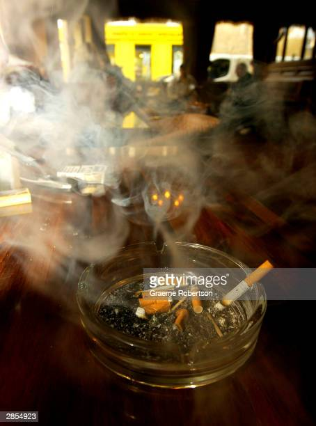 Cigarettes smoulder in a pub ashtray January 9 2004 in London England The British Medical Association is urging Scotland to take a lead in...
