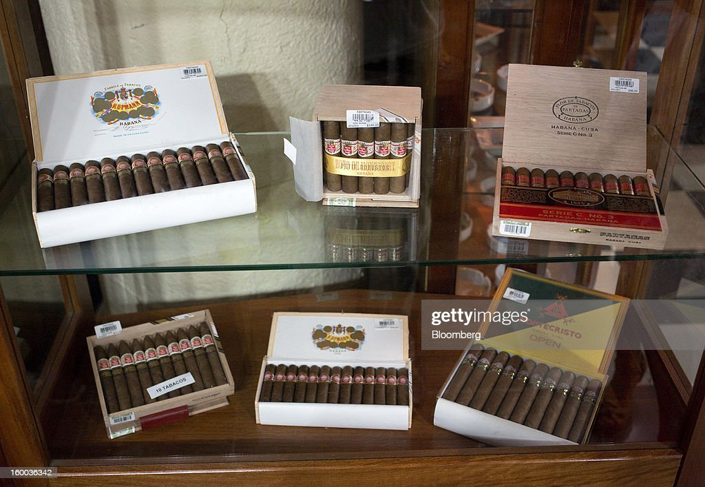 Cigars boxes sit for sale in the store at the Partagas cigar factory in Havana, Cuba, on Thursday, Jan. 17. 2013. In a country where the average monthly salary is $19, according to Cuba's statistics agency, even buying an airplane ticket will be beyond the reach of most of the island's 11 million residents as President Raul Castro begins easing travel rules on the communist island. Photographer: Andrey Rudakov/Bloomberg via Getty Images