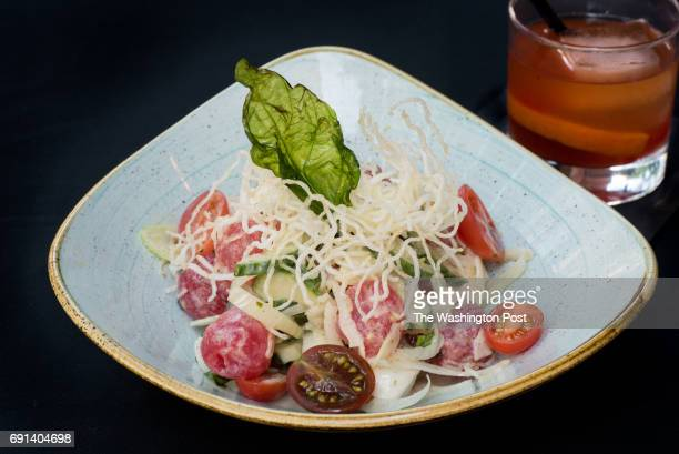 SALAD Ciliegine Mozzarella Tomatoes English Cucumbers Fennel Torn Basil Glass Noodles Citrus Vinaigrette with an Old Fashion in background at Hen...