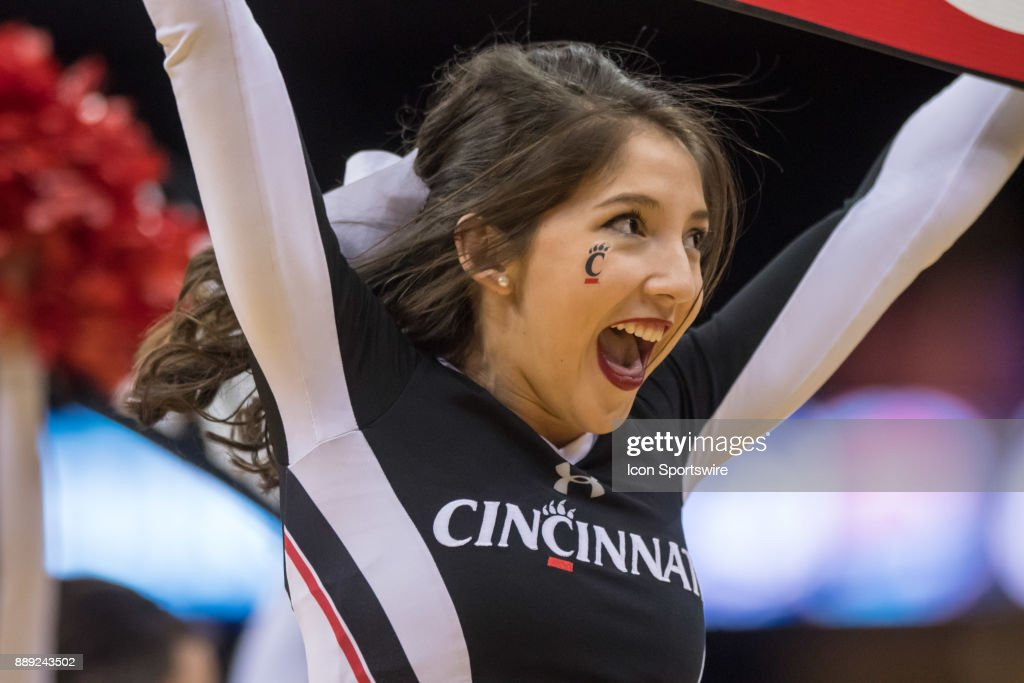 Cincinnati Bearcats cheerleader during the second half of the Never Forget Tribute Classic college basketball game between the Cincinnati Bearcats and the Florida Gators on December 9, 2017, at the Prudential Center in Newark, NJ.