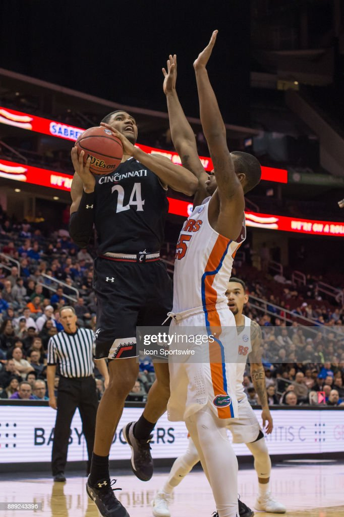 Cincinnati Bearcats forward Kyle Washington (24) drives to the basket during the first half of the Never Forget Tribute Classic college basketball game between the Cincinnati Bearcats and the Florida Gators on December 9, 2017, at the Prudential Center in Newark, NJ.
