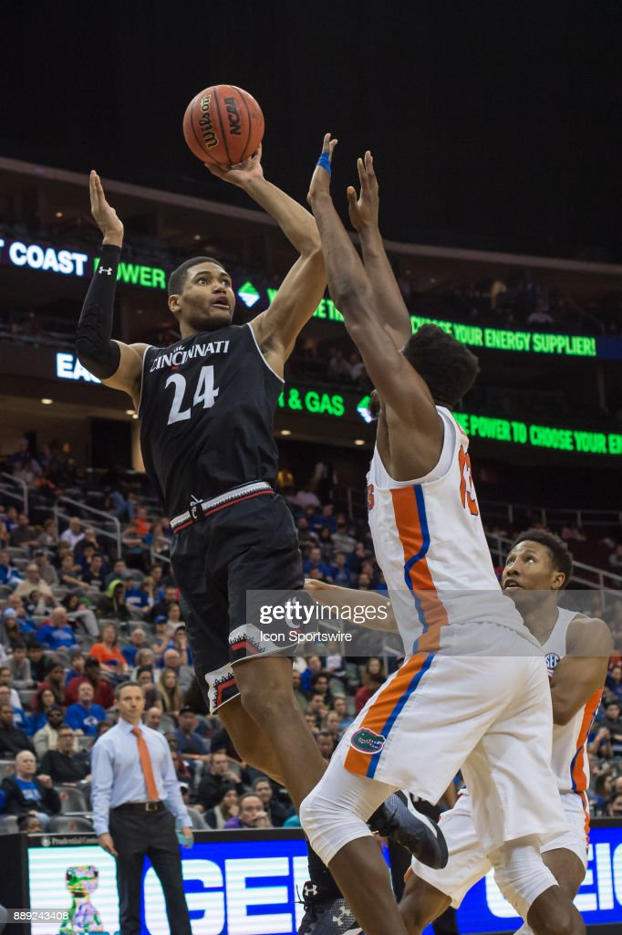Cincinnati Bearcats forward Kyle Washington (24) shoots the ball during the first half of the Never Forget Tribute Classic college basketball game between the Cincinnati Bearcats and the Florida Gators on December 9, 2017, at the Prudential Center in Newark, NJ.