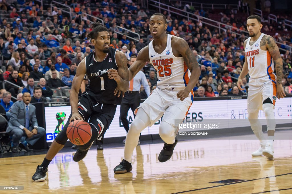Cincinnati Bearcats guard Jacob Evans (1) drives to the basket during the first half of the Never Forget Tribute Classic college basketball game between the Cincinnati Bearcats and the Florida Gators on December 9, 2017, at the Prudential Center in Newark, NJ.