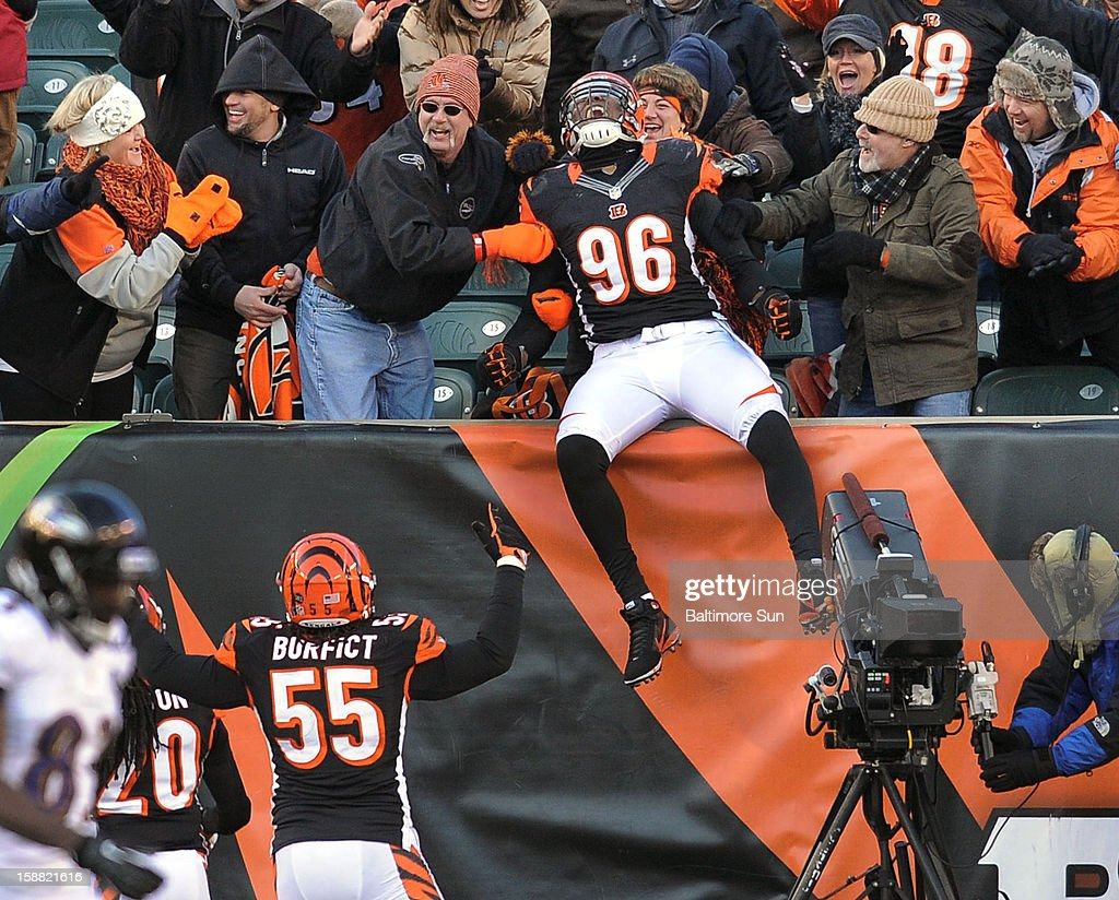 Cincinnati Bengals' Carlos Dunlap (96) celebrates with the crowd after he intercepted a pass for a touchdown at Paul Brown Stadium on Sunday, December 30, 2012, in Cincinnati, Ohio. The Cincinnati Bengals defeated the Baltimore Ravens, 23-17.