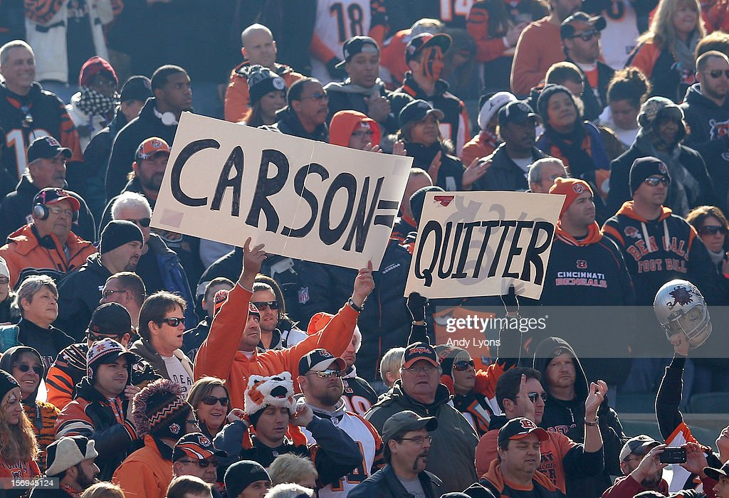 Cincinnati Bengals fans hold up a sign welcoming back former Bengals quarterback Carson Plamer during the NFL game against the Oakland Raiders at Paul Brown Stadium on November 25, 2012 in Cincinnati, Ohio.