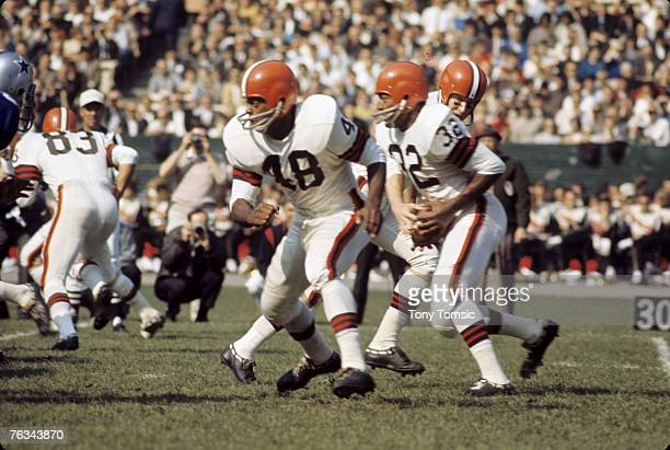 Cincinnati Bengals fullback Ernie Green leads the blocking for Hall of Fame running back Jim Brown circa the mid1960s