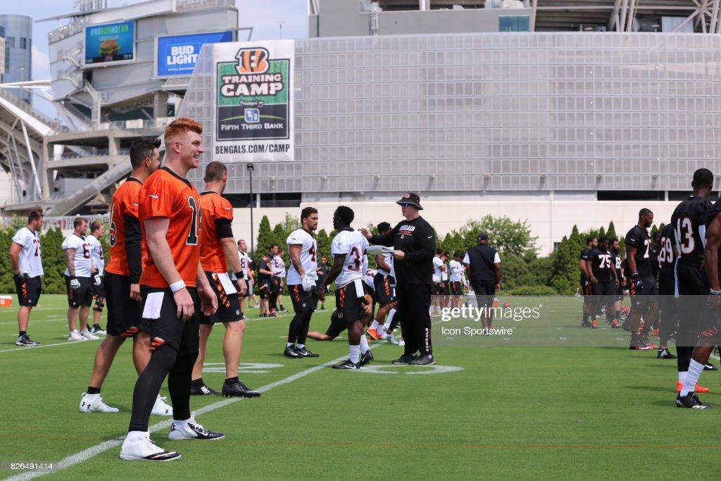 Cincinnati Bengals quarterback Andy Dalton (14) warms up with his teammates before Cincinnati Bengals training camp practice on July 28th, 2017, in Cincinnati, OH.