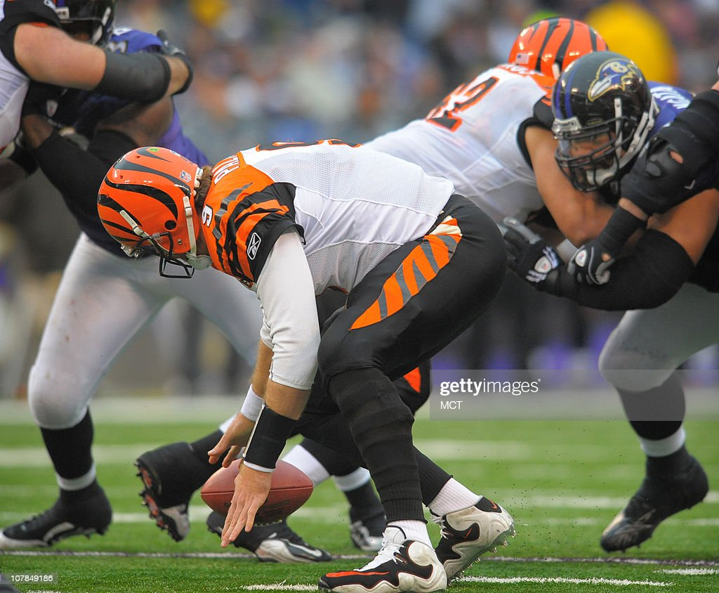 Cincinnati Bengals quarterback Carson Palmer recovers his own fumbled snap during the second half. The Ravens defeat Cincinnati 13-7 on Sunday, January 2, 2011, at M&T Bank Stadium in Baltimore, Maryland.