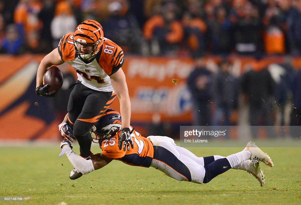 Cincinnati Bengals tight end <a gi-track='captionPersonalityLinkClicked' href=/galleries/search?phrase=Tyler+Kroft&family=editorial&specificpeople=11390241 ng-click='$event.stopPropagation()'>Tyler Kroft</a> (81) gets wrapped up by Denver Broncos cornerback <a gi-track='captionPersonalityLinkClicked' href=/galleries/search?phrase=Chris+Harris+-+American+Football+Cornerback&family=editorial&specificpeople=15029474 ng-click='$event.stopPropagation()'>Chris Harris</a> (25) during the fourth quarter December 28, 2015 at Sports Authority Field at Mile High Stadium.