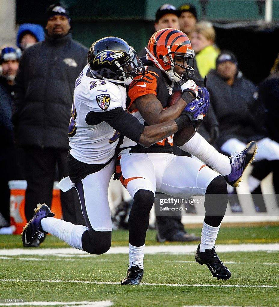 Cincinnati Bengals' wide receiver Brandon Tate, right, catches a 44-yard pass in front of Baltimore Ravens cornerback Chykie Brown, left, in the fourth quarter at Paul Brown Stadium on Sunday, December 30, 2012, in Cleveland, Ohio. The Cincinnati Bengals defeated the Baltimore Ravens, 23-17.