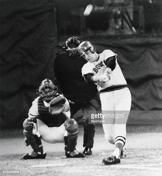 Carlton Fisk of the Red Sox connects for a home run in the second inning against the Reds October 14 in game 3 of the World Series Catcher is Johnny...
