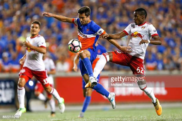 Cincinnati forward Andrew Wiedeman battles New York Red Bulls defender Michael Murillo for possession during the semifinal match of the 2017 Lamar...