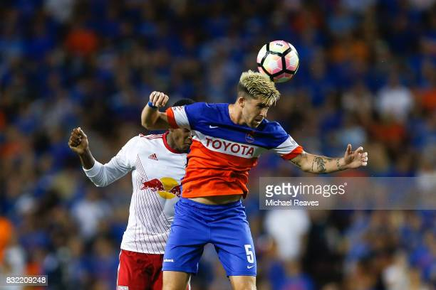 Cincinnati midfielder Aodhan Quinn fields a header against the New York Red Bulls during the semifinal match of the 2017 Lamar Hunt US Open Cup at...