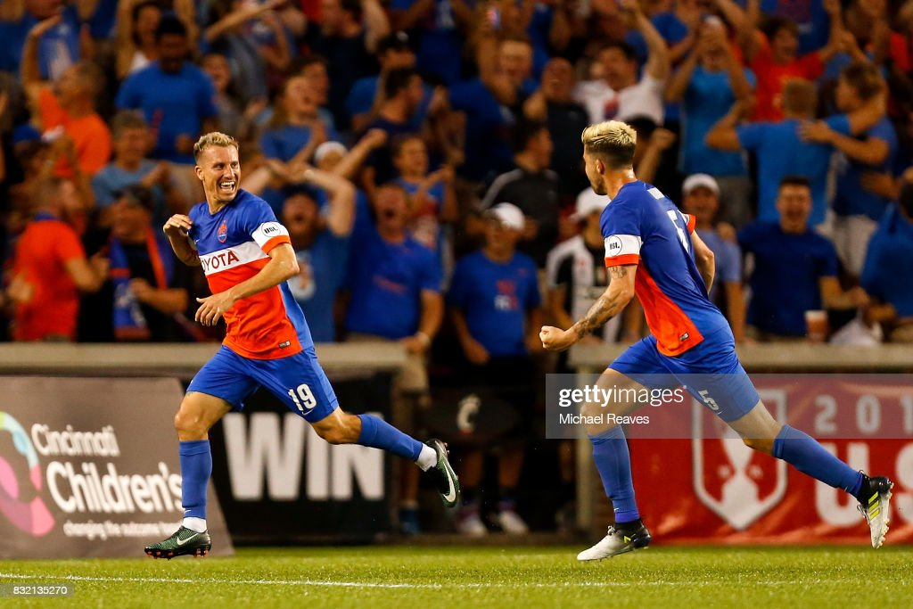 FC Cincinnati midfielder Corben Bone #19 celebrates with Aodhan Quinn #5 after scoring a goal in the first half against the New York Red Bulls during the semifinal match of the 2017 Lamar Hunt U.S. Open Cup at Nippert Stadium on August 15, 2017 in Cincinnati, Ohio.