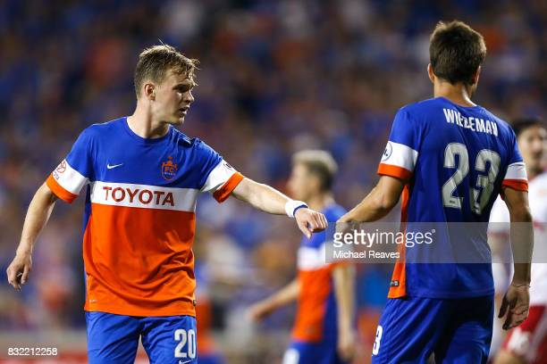 Cincinnati midfielders Jimmy McLaughlin and Andrew Wiedeman celebrate against the New York Red Bulls during the semifinal match of the 2017 Lamar...
