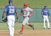 Cincinnati Reds center fielder ShinSoo Choo rounds the bases on his firstinning home run off of Texas Rangers starting pitcher Nick Tepesch at...