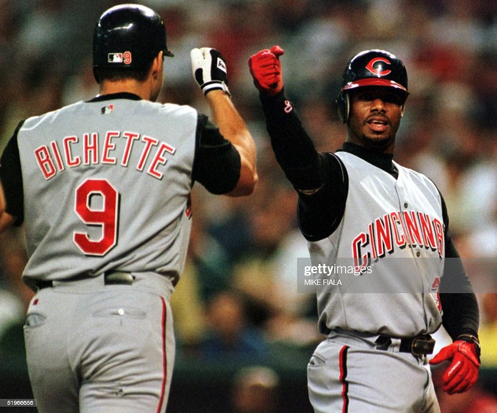 Cincinnati Reds Dante Bichette (L) is congratulated by teammate Ken Griffey Jr. (R) after he hit a two-run homer off Arizona Diamondbacks starting pitcher Armando Reynoso during the first inning 01 July 2000 in Phoenix. The Diamondbacks won 9-6.