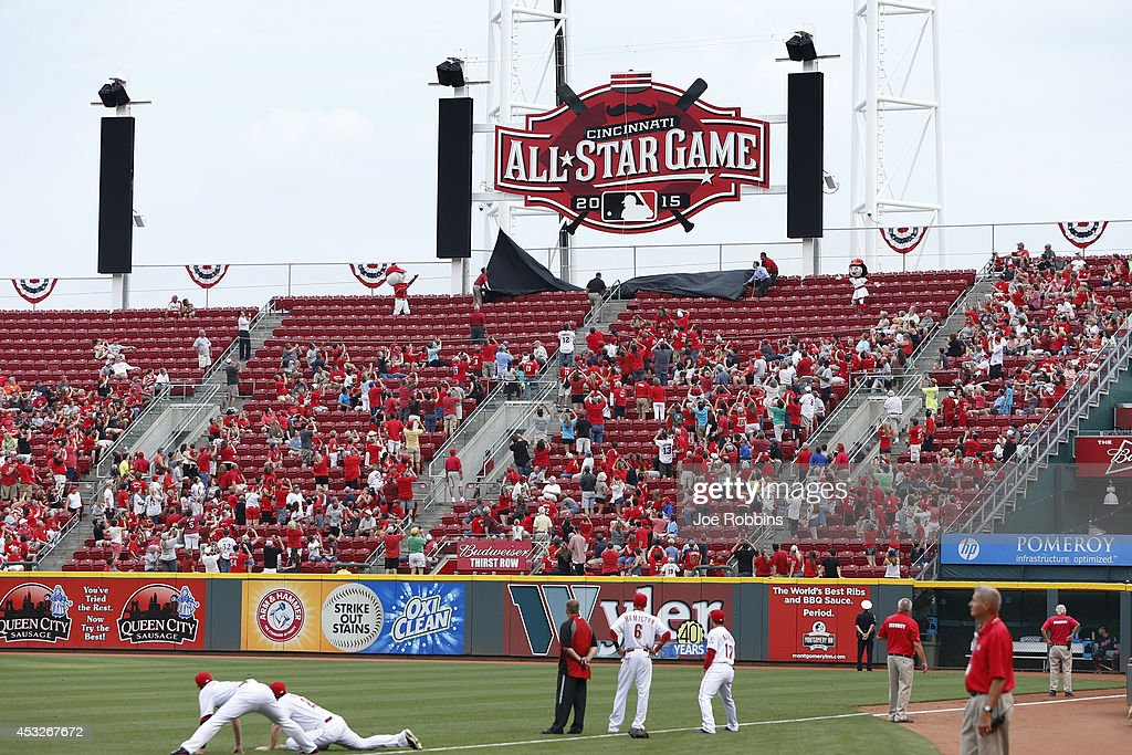 Cincinnati Reds fans look on as the 2015 All Star Game logo is unveiled prior to the game against the Cleveland Indians at Great American Ball Park...
