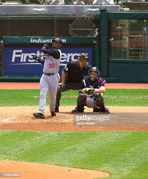 Cincinnati Reds' Ken Griffey Jr hits a solo home run off Cleveland Indians pitcher Cliff Lee in the third inning for Griffey's 499th career home run...