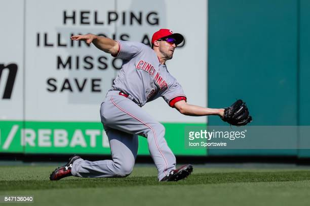 Cincinnati Reds left fielder Adam Duvall makes a sliding catch for an out during the seventh inning of a baseball game against the St Louis Cardinals...