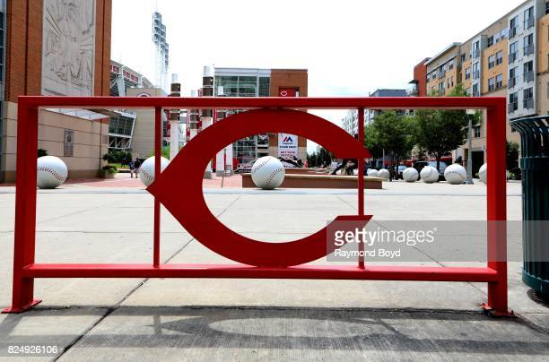 Cincinnati Reds logofence and baseball sculptures sits outside Great American Ball Park home of the Cincinnati Reds baseball team in Cincinnati Ohio...