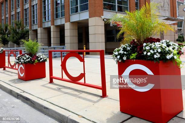 Cincinnati Reds logoflower pots and fences sits outside Great American Ball Park home of the Cincinnati Reds baseball team in Cincinnati Ohio on July...