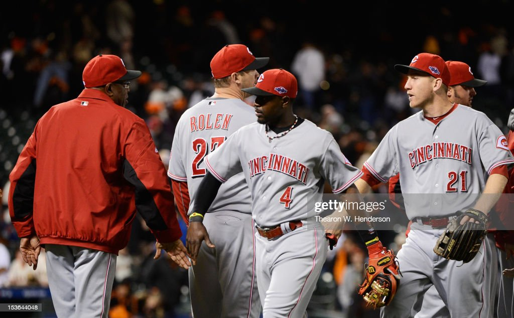 Cincinnati Reds Manager <a gi-track='captionPersonalityLinkClicked' href=/galleries/search?phrase=Dusty+Baker&family=editorial&specificpeople=202908 ng-click='$event.stopPropagation()'>Dusty Baker</a> and Brandon Phillips #4 celebrate their 9 to 0 win over the San Francisco Giants in Game Two of the National League Division Series at AT&T Park on October 7, 2012 in San Francisco, California.