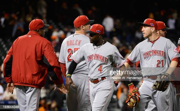 Cincinnati Reds Manager Dusty Baker and Brandon Phillips celebrate their 9 to 0 win over the San Francisco Giants in Game Two of the National League...
