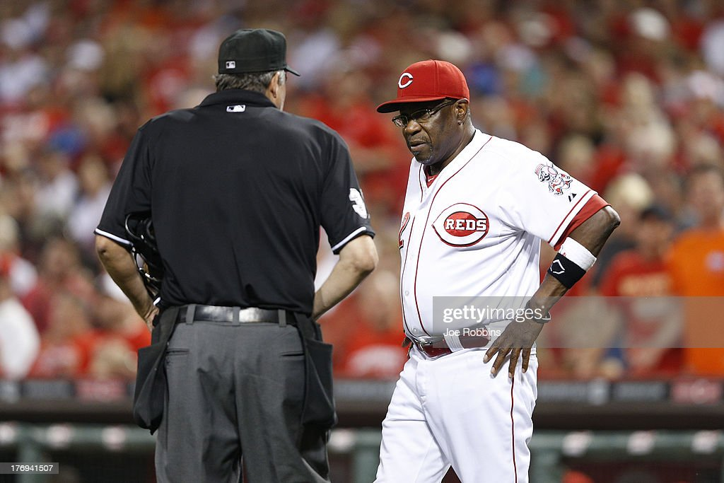 Cincinnati Reds manager Dusty Baker argues with home plate umpire Gary Darling during the game against the Arizona Diamondbacks at Great American Ball Park on August 19, 2013 in Cincinnati, Ohio. The Reds won 5-3.