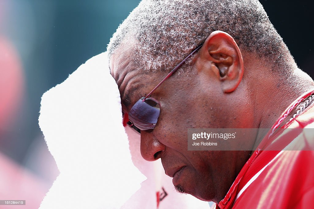 Cincinnati Reds manager <a gi-track='captionPersonalityLinkClicked' href=/galleries/search?phrase=Dusty+Baker&family=editorial&specificpeople=202908 ng-click='$event.stopPropagation()'>Dusty Baker</a> wipes sweat off his head during the game against the Philadelphia Phillies at Great American Ball Park on September 5, 2012 in Cincinnati, Ohio. The Phillies won 6-2.