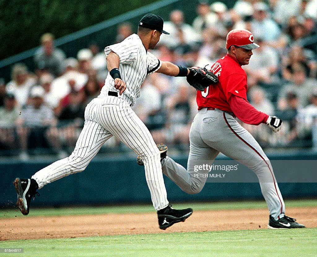 Cincinnati Reds' outfielder Dante Bichette (R) is tagged by New York Yankees' Derek Jeter in the third inning at Legends Field 19 March 2000 in Tampa, FL. Bichette tried to steal second base. The Reds beat the Yankees 3-1. AFP PHOTO/Peter MUHLY