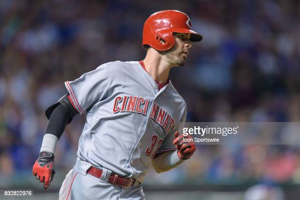 Cincinnati Reds outfielder Jesse Winker singles in the 7th inning during an MLB game between the Cincinnati Reds and the Chicago Cubs on August 15 at...