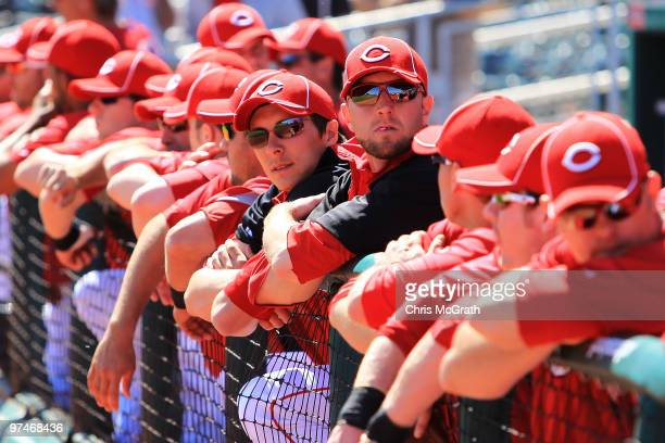 Cincinnati Reds players wait in the dugout for play to begin against the Cleveland Indians during a spring training game at Goodyear Ballpark on...