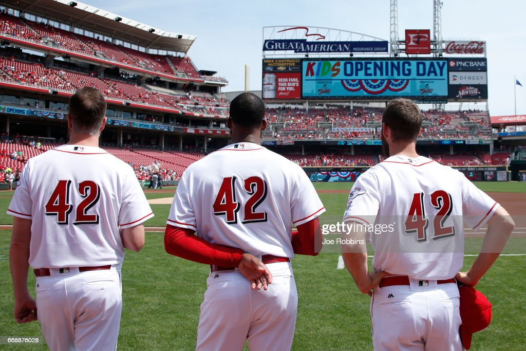 Cincinnati Reds players wear No. 42 in honor of Jackie Robinson Day as they stand for the national anthem prior to a game against the Milwaukee Brewers at Great American Ball Park on April 15, 2017 in Cincinnati, Ohio.