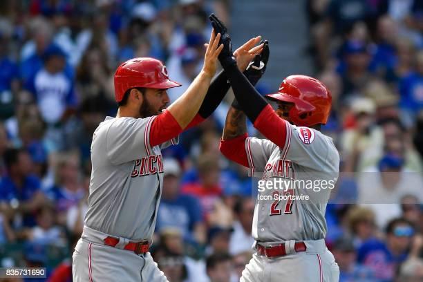 Cincinnati Reds right fielder Phillip Ervin and Cincinnati Reds third baseman Eugenio Suarez celebrate at the plate after Cincinnati Reds right...