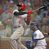 Cincinnati Reds second baseman Brandon Phillips watches the flight of his grand slam ball to left field against the Chicago Cubs during the third...