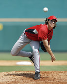 Cincinnati Reds starting pitcher Homer Bailey makes a pitch in Sunday's game against Pittsburgh at McKechnie Field in Bradenton Florida on March 4...