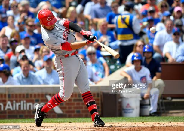 Cincinnati Reds third baseman Eugenio Suarez hits a RBI single during the game between the Cincinnati Reds and the Chicago Cubs on August 17 2017 at...